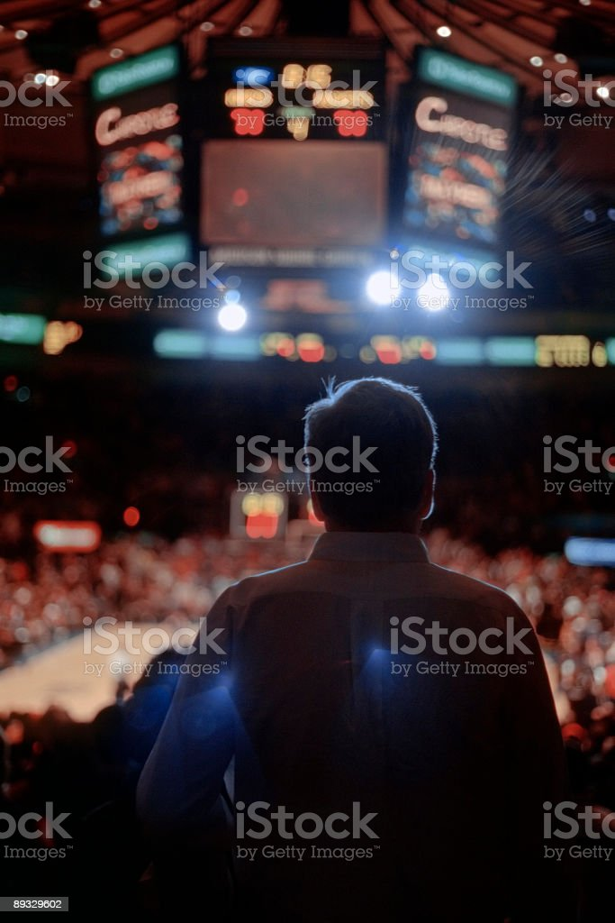 Backlit Man Watching Sporting Event - New York City stock photo