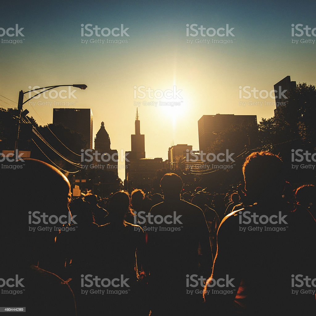 backlit of people at festival on the city stock photo