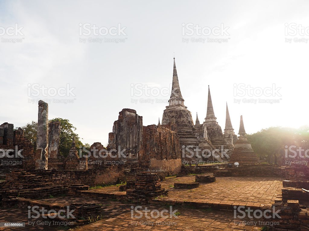 backlit picture of big old brick pagoda stock photo