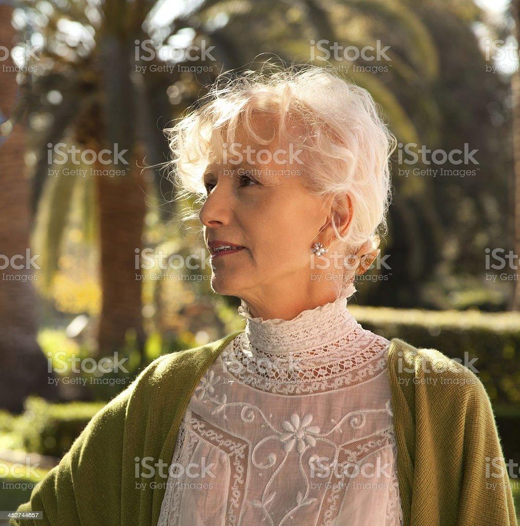 Back-lit Senior Female stock photo