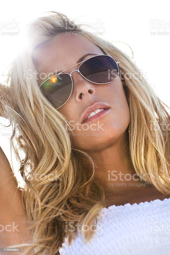 Backlit Sexy Blond Girl In White Bikini stock photo