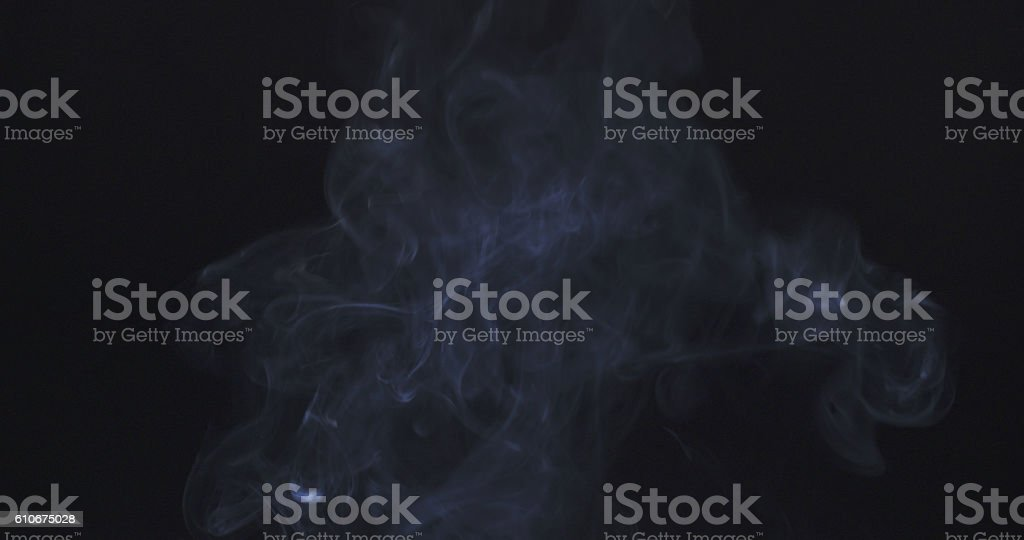 backlit smoke background over black stock photo
