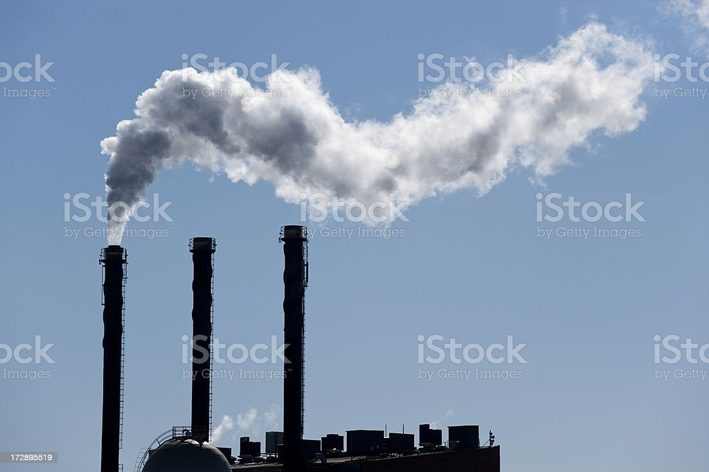 Backlit smoke from a chimney royalty-free stock photo
