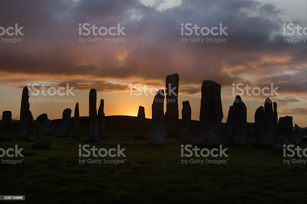 Backlit standing stones stock photo