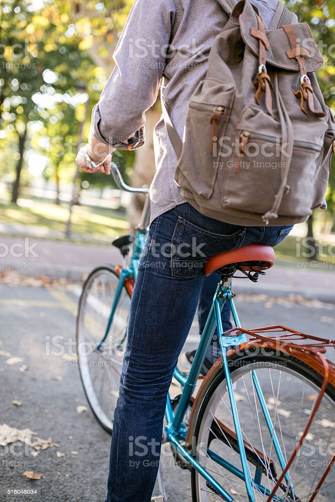 Backpack and bicyle, only the sky is limit stock photo