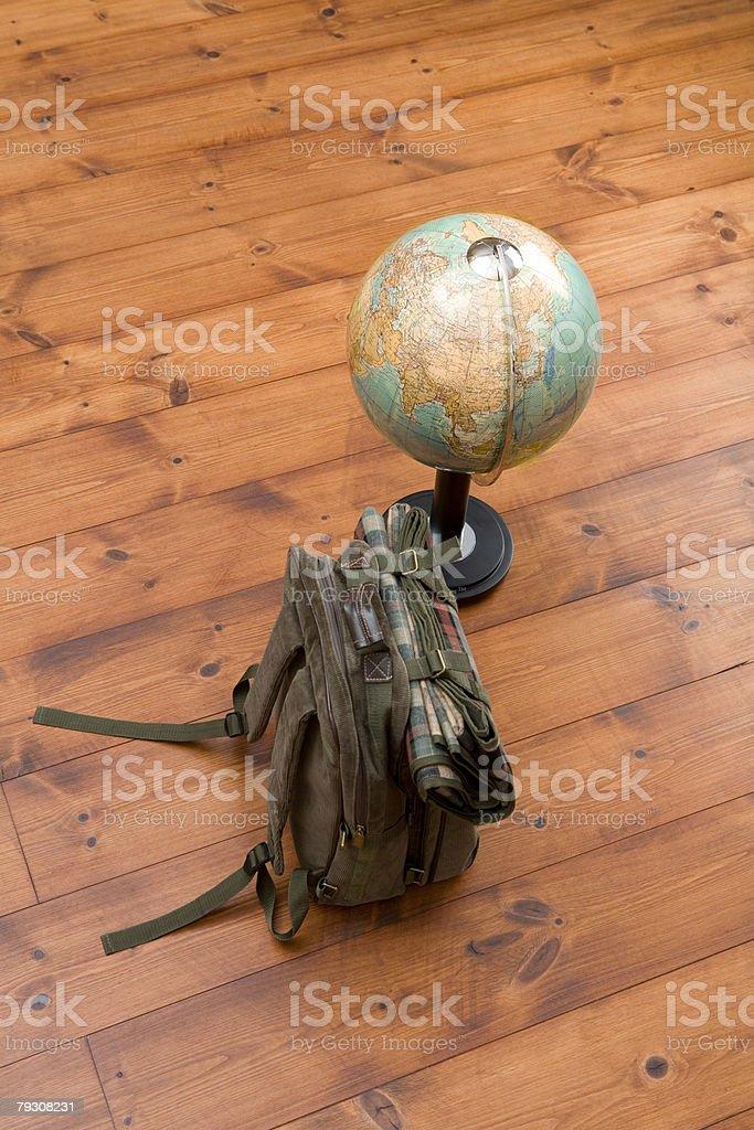 Backpack and globe stock photo