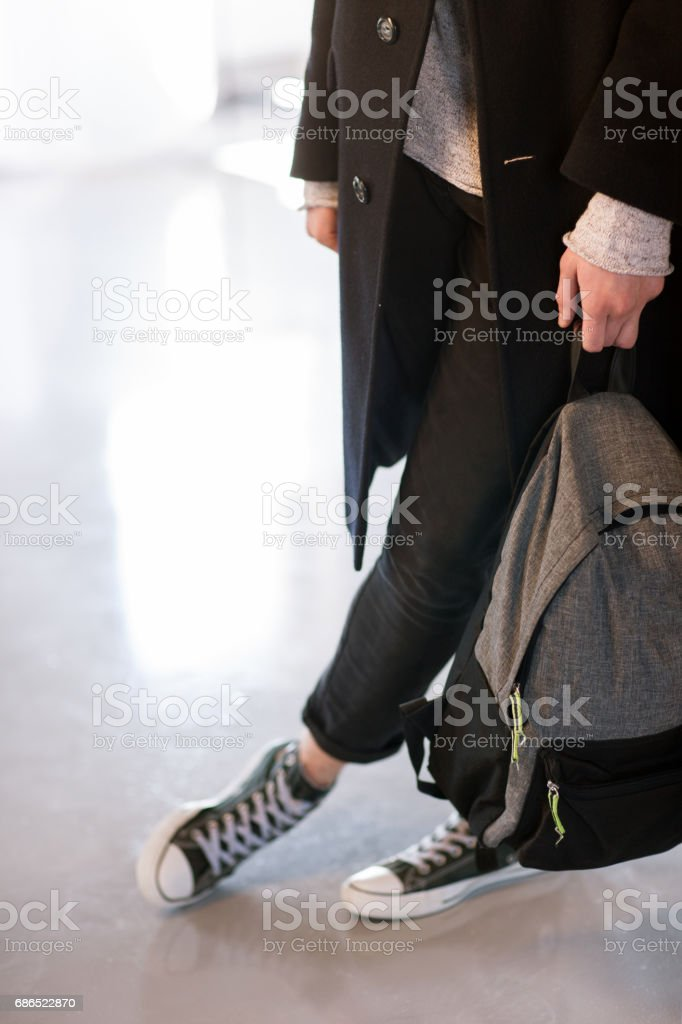 Backpack in male hands close up stock photo