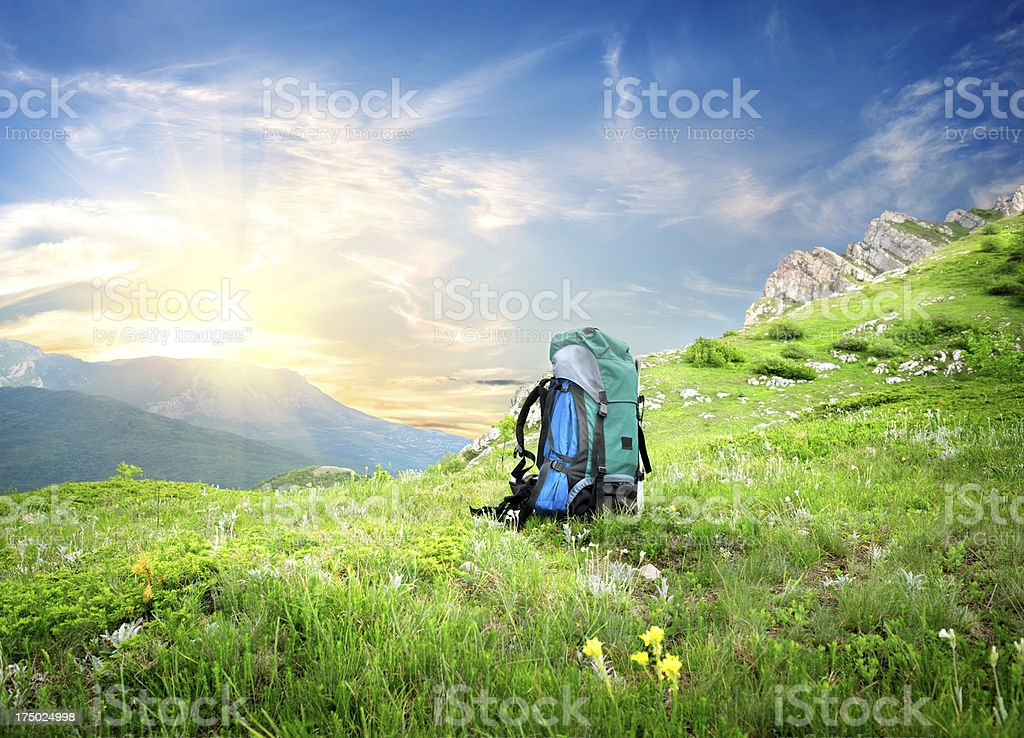 Backpack in mountains royalty-free stock photo