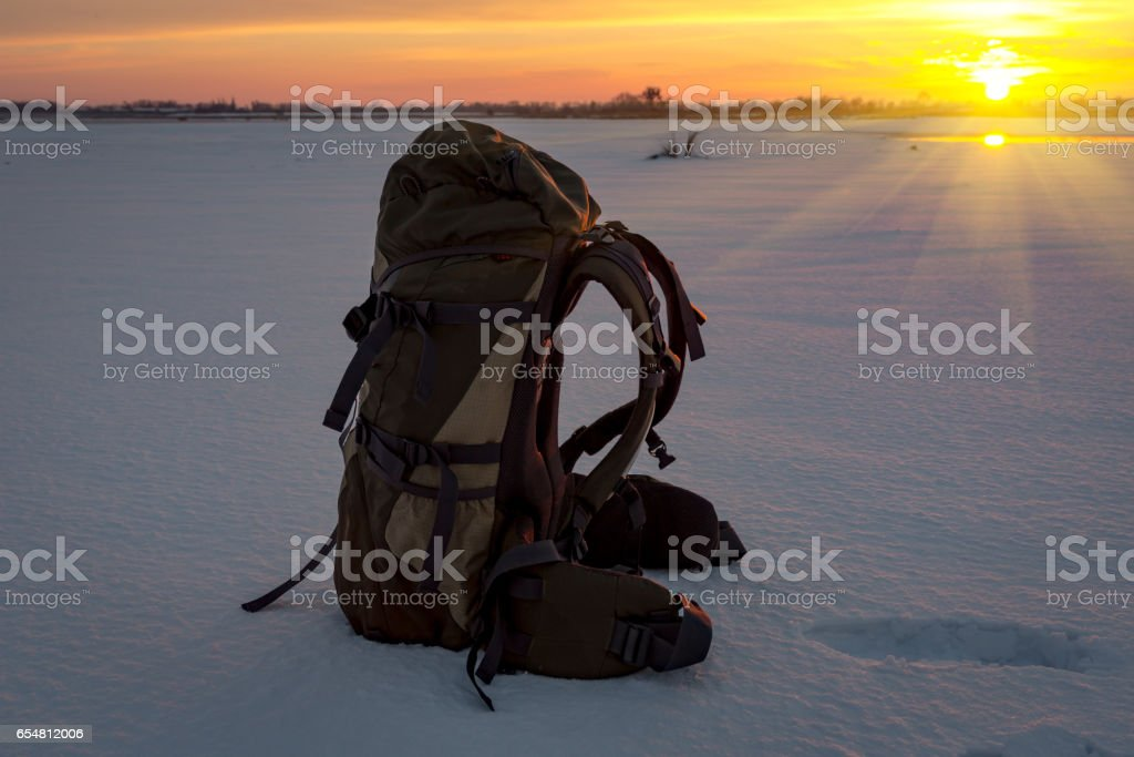 backpack on snow stock photo