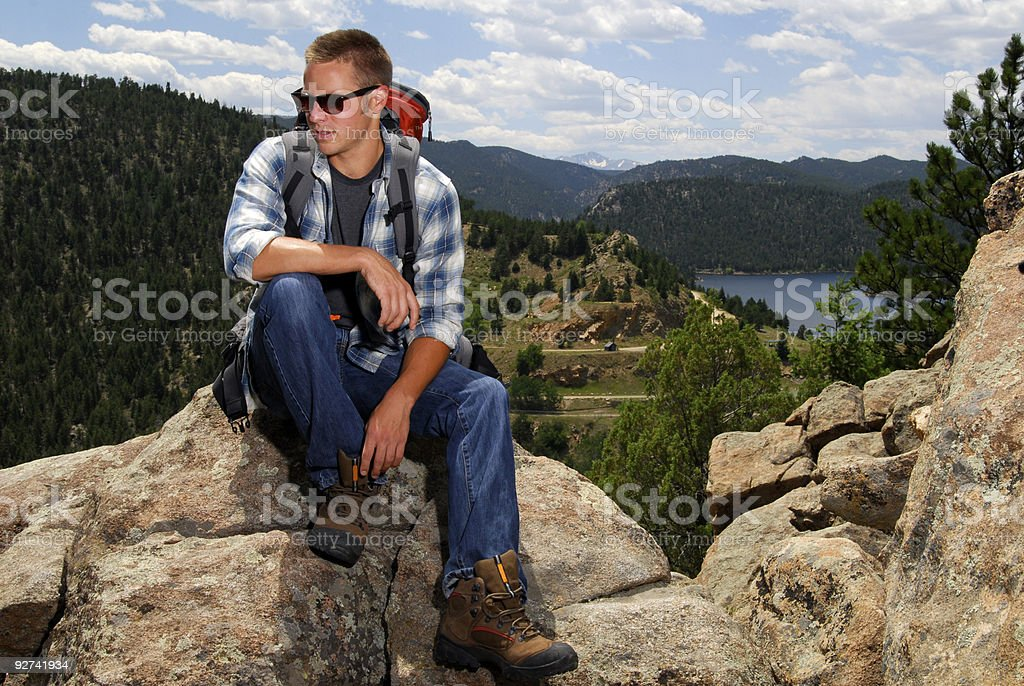 Backpacker above a lake royalty-free stock photo