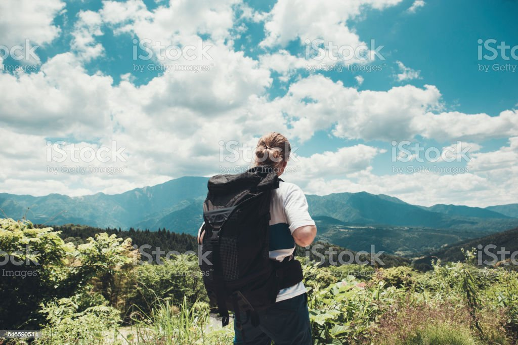 Backpacker Admiring a Scenic View stock photo