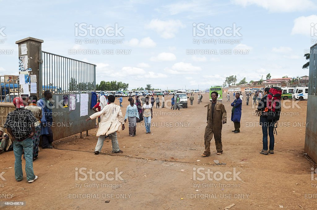 Backpacker and local Ethiopians at bus station in Sodo stock photo