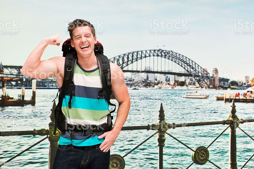 Backpacker cheering outdoors stock photo