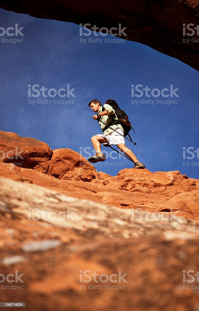 Backpacker Climbing On Dangerous Rocks In Moab, Utah royalty-free stock photo