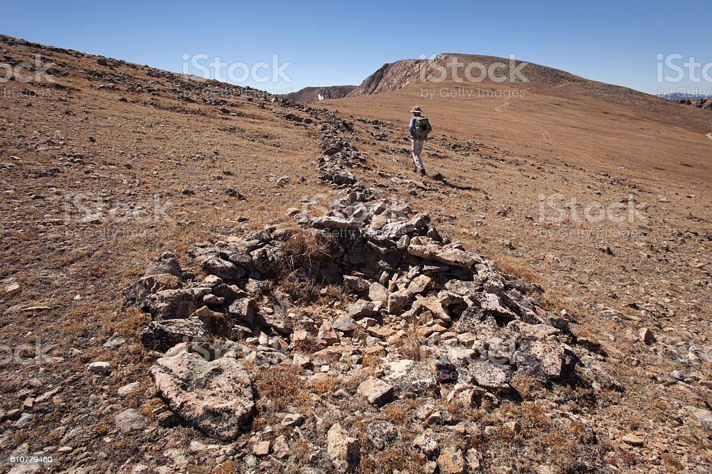 Backpacker hikes Native American game-drive blind James Peak Wilderness Colorado stock photo