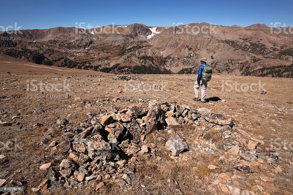 Backpacker hikes Native American game-drive blind James Peak Wilderness Colorado stock photo