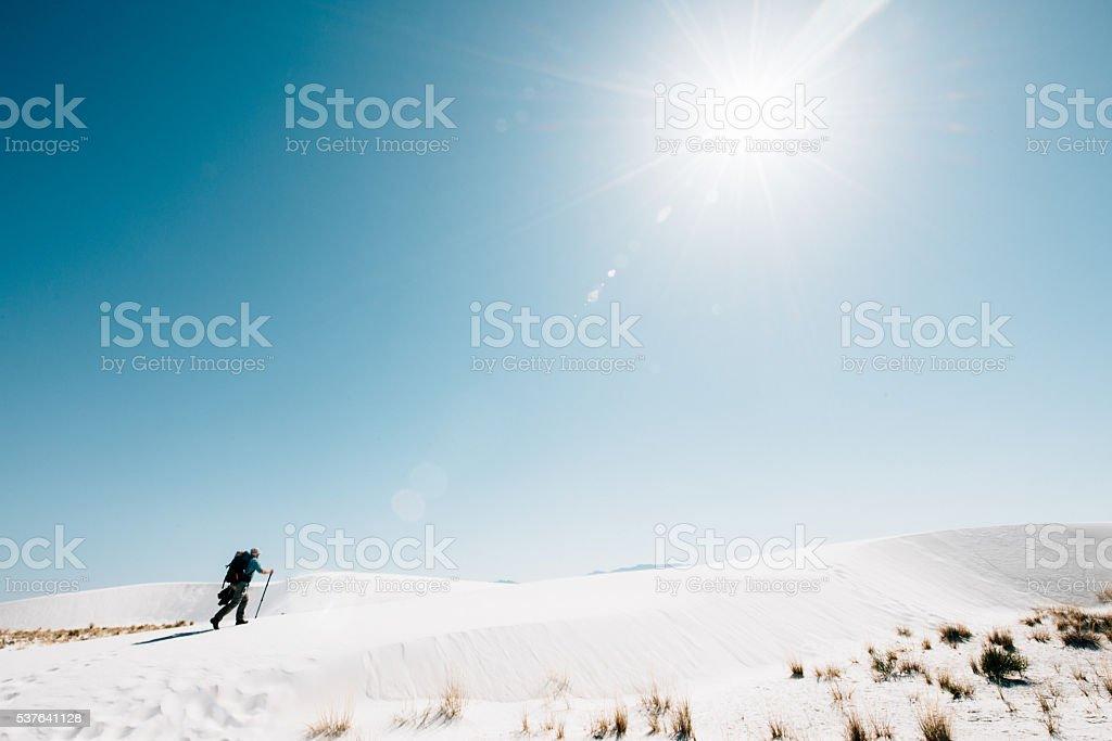 Backpacker Hiking in The Desert stock photo