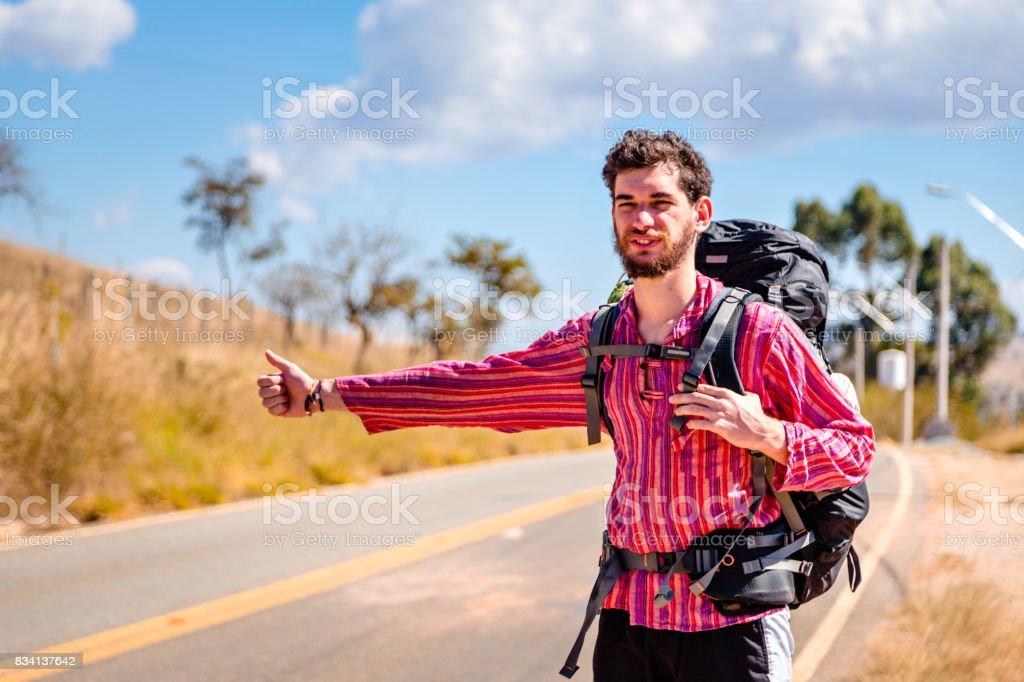 Backpacker Hitchhiking. stock photo