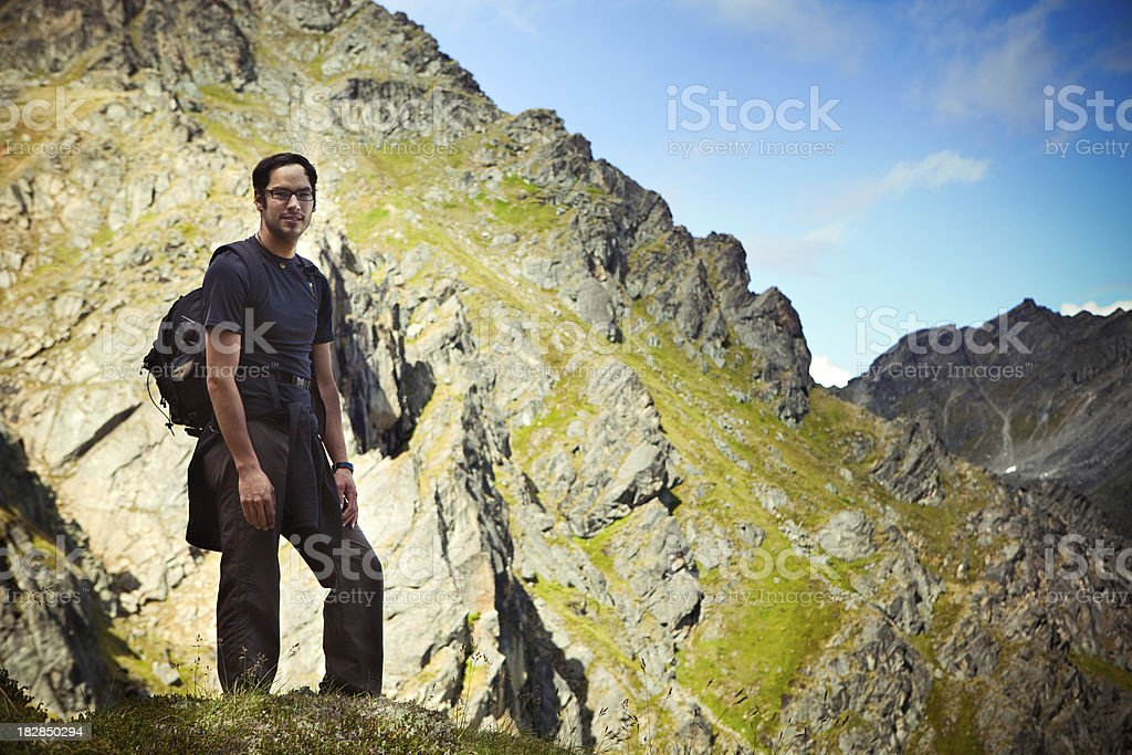 Backpacker In Alaskan Mountain Range stock photo
