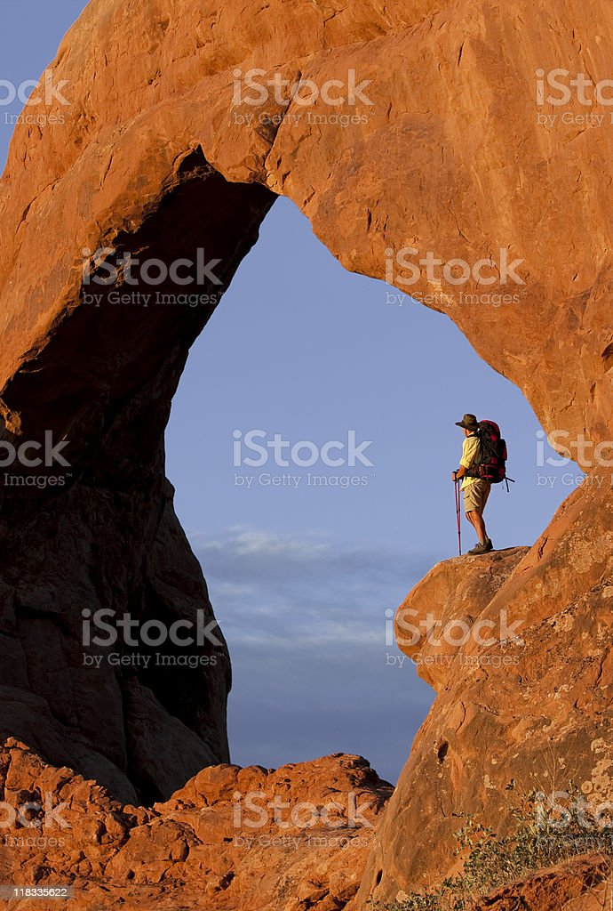 Backpacker Looking At View In Arches National Park Moab, Utah stock photo