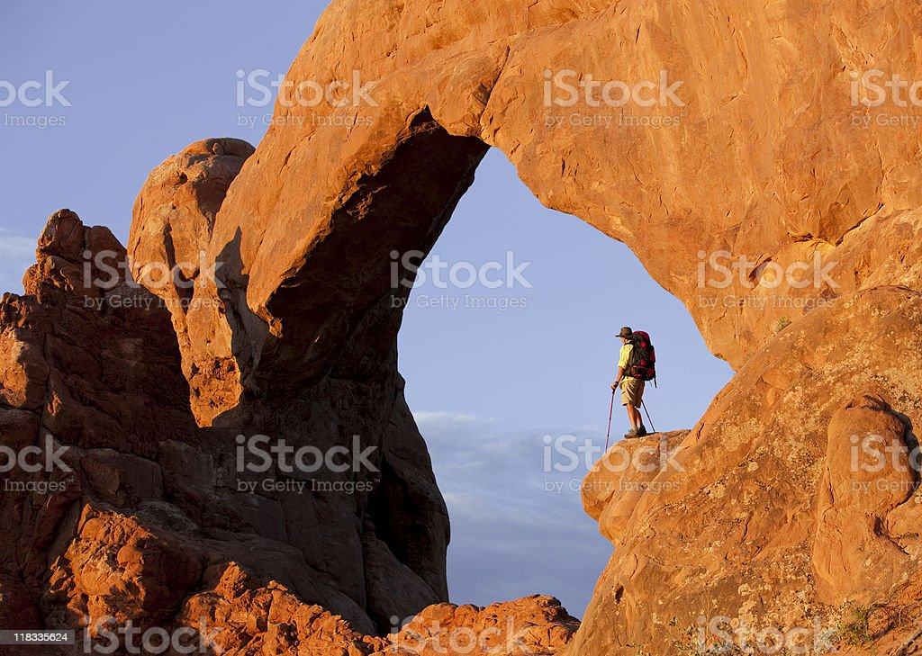 Backpacker Looking At View In Arches National Park royalty-free stock photo