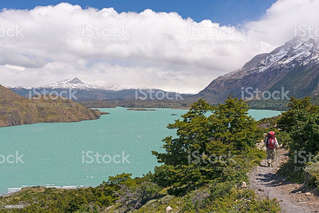Backpacker on a Remote Trail in the Patagonian Andes stock photo