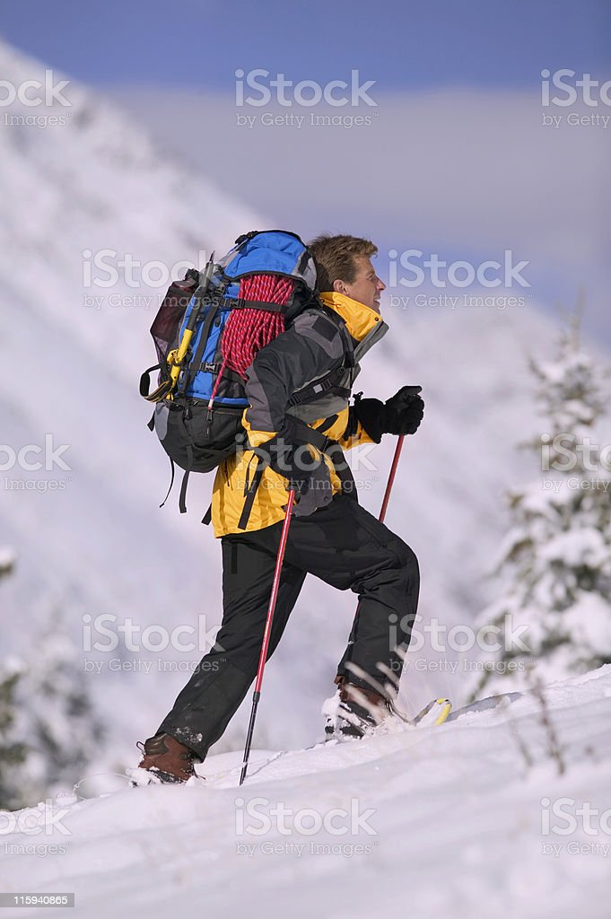 Backpacker on Snowshoes royalty-free stock photo