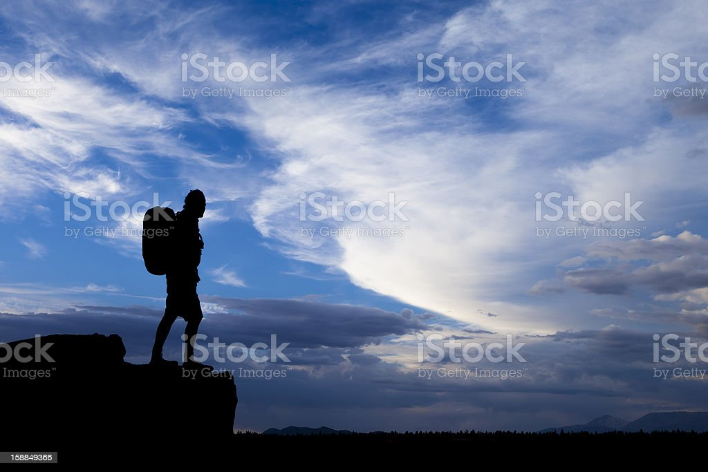 Backpacker on the edge stock photo