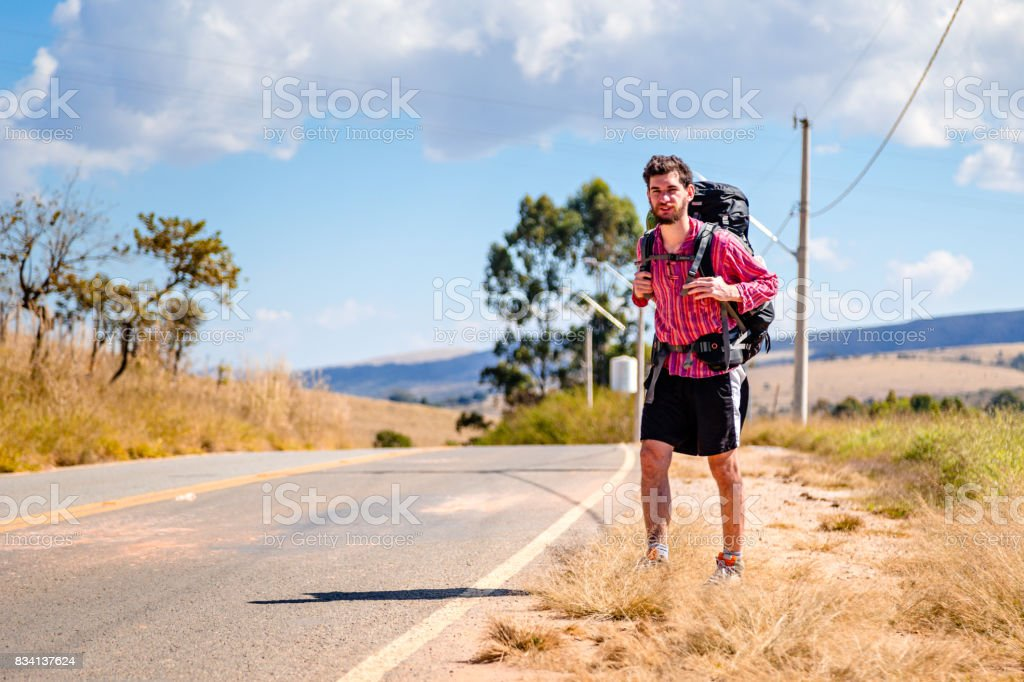 Backpacker on the road stock photo