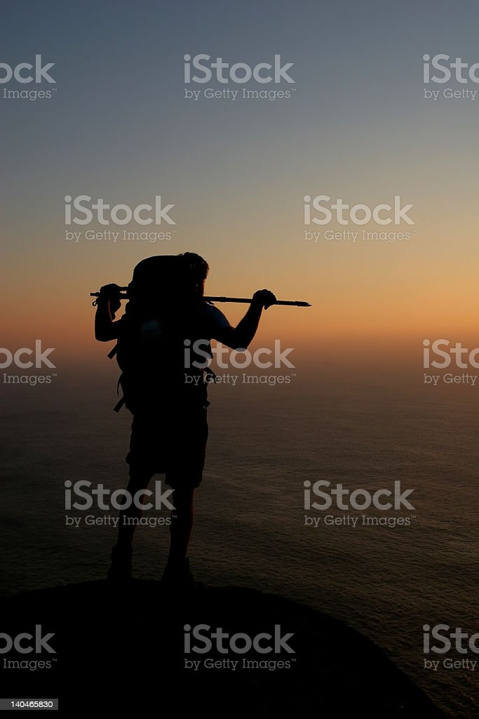 Backpacker overlooking the Sea royalty-free stock photo