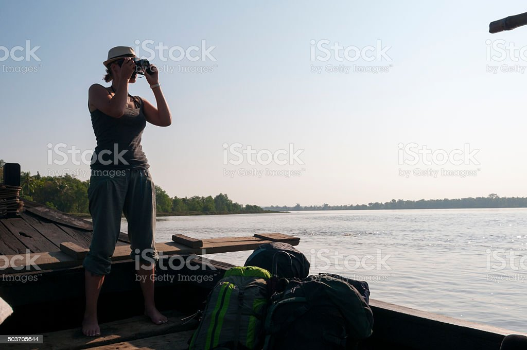 Backpacker photographing landscape - Thanlwin River, Burma stock photo