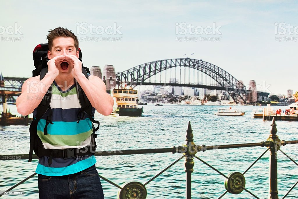 Backpacker shouting outdoors stock photo