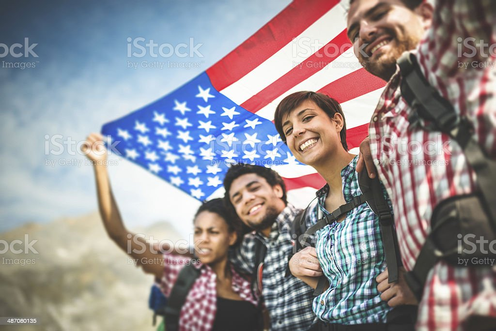 backpacker togetherness with american flag stock photo