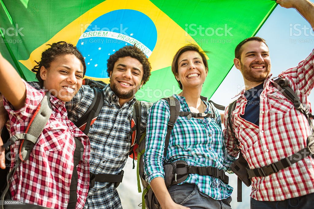 backpacker togetherness with brazil flag stock photo