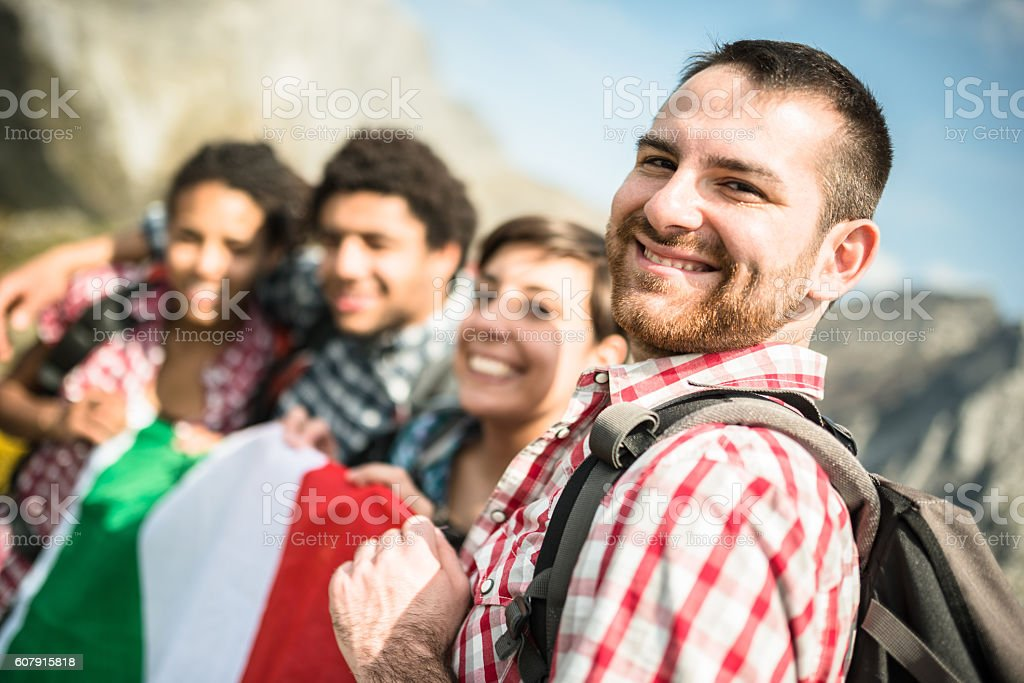 backpacker togetherness with italian flag stock photo