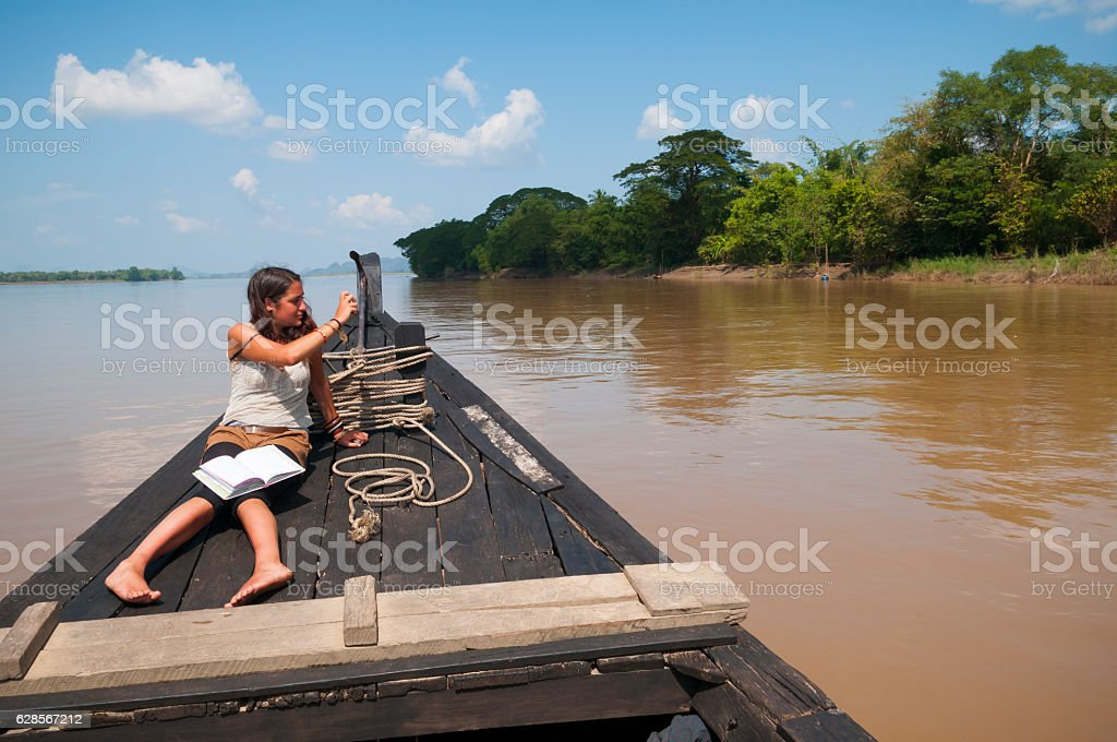 Backpacker traveling with camera and journal in Burma stock photo