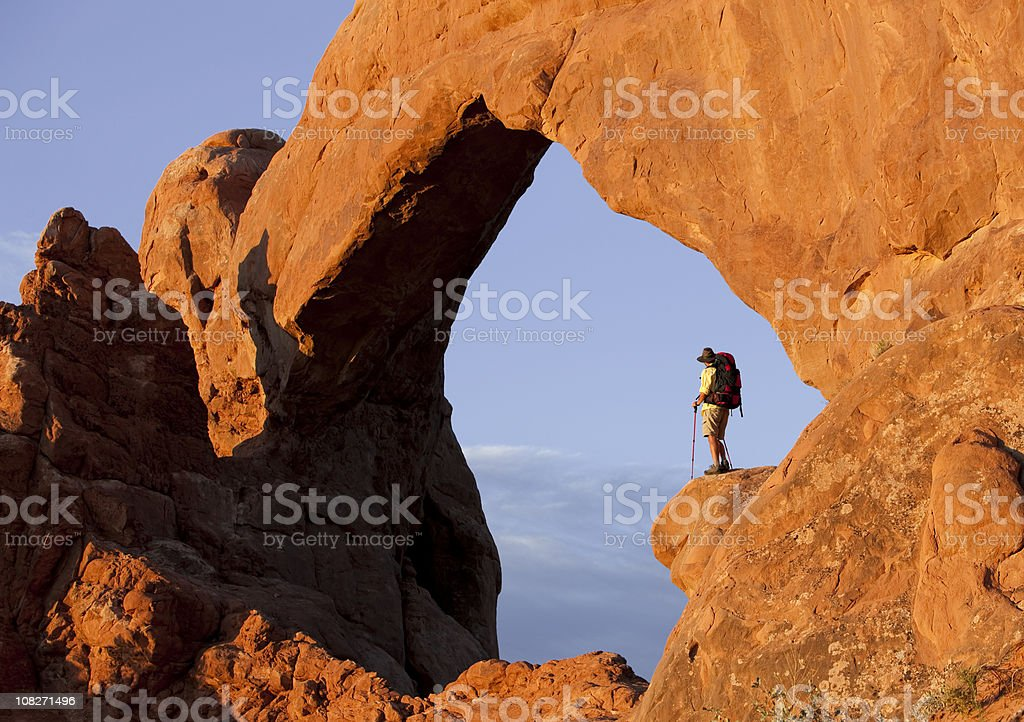 Backpacker Under Famous Arch In Arches National Park royalty-free stock photo