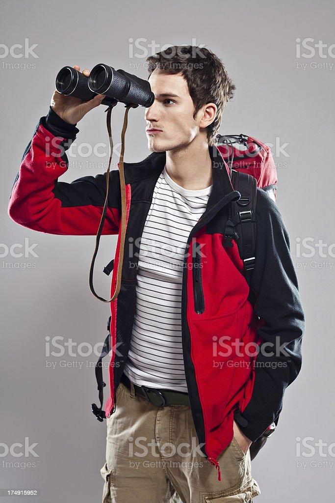 Backpacker with binoculars royalty-free stock photo