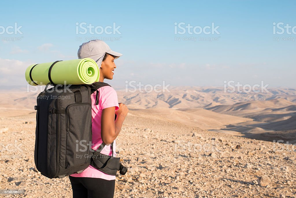 Backpacker woman at Judean desert. stock photo