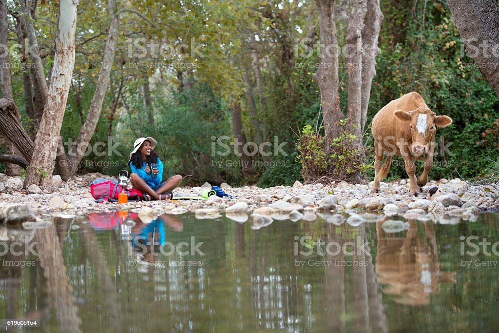 Backpacker woman enjoying the nature. stock photo