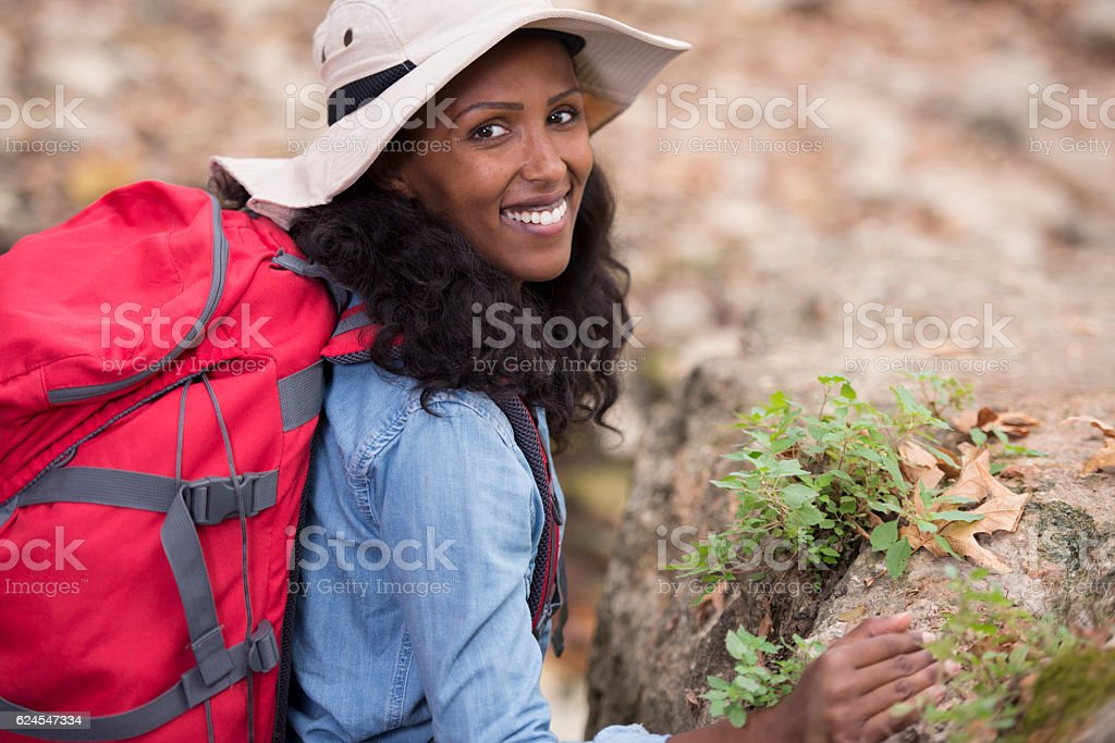 Backpacker woman walking outdoor. stock photo