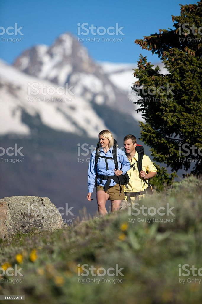 Backpackers Hiking On Side Of Mountain In Colorado royalty-free stock photo
