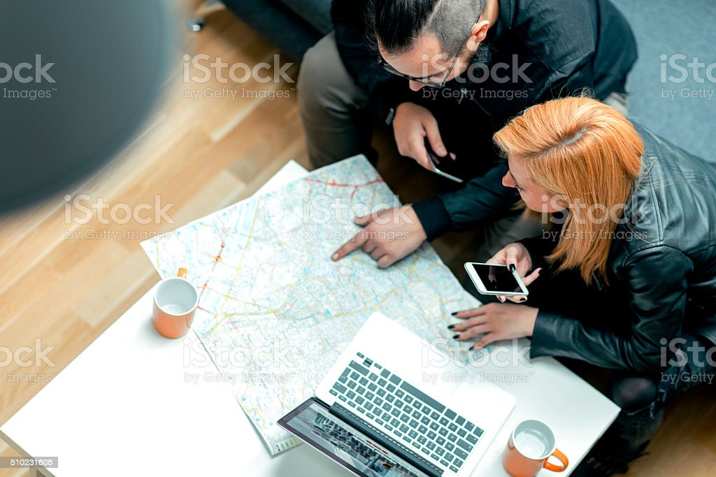 Backpackers Looking For Apartment Online. stock photo