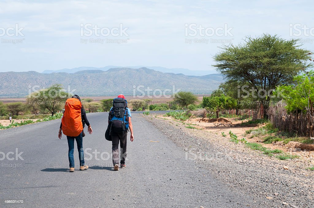 Backpackers on the road in southern Ethiopia stock photo