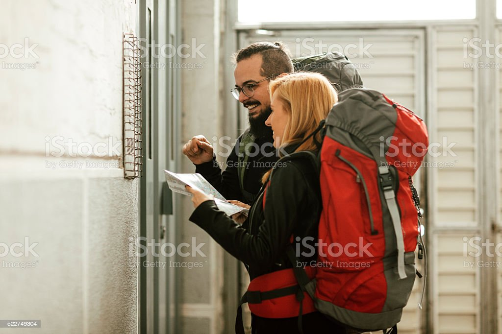 Backpackers Renting Apartment. stock photo