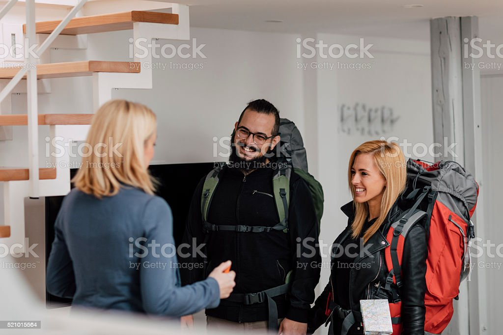 Backpackers renting apratment. stock photo