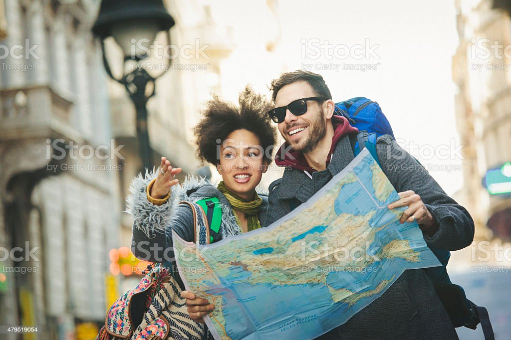 Backpackers walking and using map stock photo