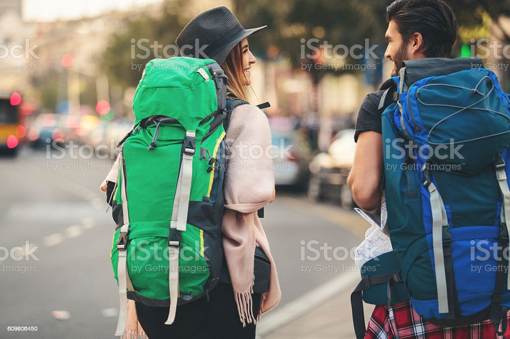 Backpackers walking rear view stock photo