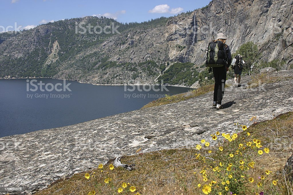 Backpackers with Waterfall stock photo