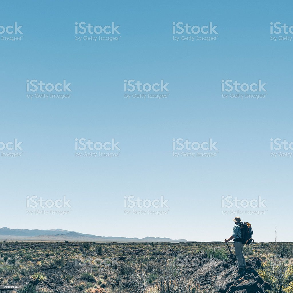 Backpacking across Valley of Fires in NM stock photo